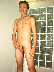 Cute asian boy posing and stripping