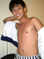 Smiley oriental boy shows his naked body