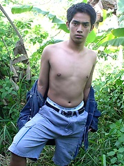 Asian guy posing in the jungle