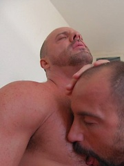 Carlo Cox arrives to give Butch his rental and is quickly invited in for a rub down.