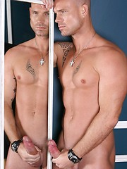 Sexual hunky boss posing before mirror