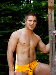 Muscled stud naked outdoors