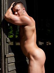 Hot muscle hunk posing outdoors