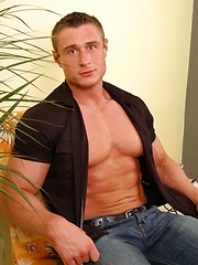 Strong pretty-faced hunk shows his muscles