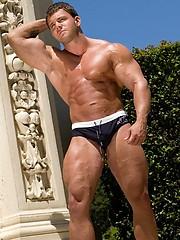 Naked bodybuilder posing under sun