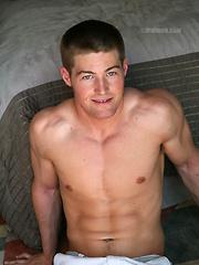 American frat jock posing in the bedroom
