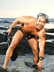 Straight swimmer guy showing his tool