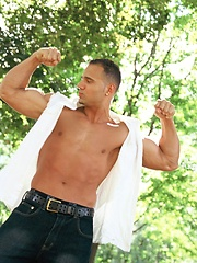 Victor Lucca poses outdoors and in a bed