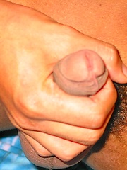 Asian boy jerking off his uncut cock
