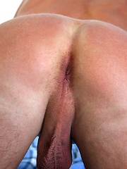 Long-haired stud showing his uncut cock