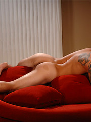 Stud macho showing his naked tattoed body