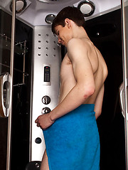 Bold twink enjoys a nice tug job in a shower cabin