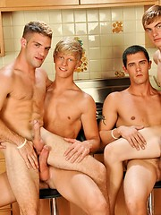 Four studs have some blowjob action on kithcen