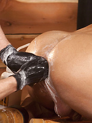 Cowboy-booted and jock-strapped Billy is on all fours as Erik prepares him for his huge fist