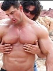 Two strong bodybuilders relaxin in the desert