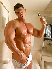 Naked supermuscle man Zeb washes his strong body