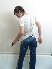 Cute teen boy Kish plays in the shower