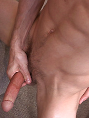 Gymnastic boy Eric plays with cock
