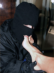 Man in mask licking Marcellos feet and then sucking his cock