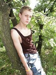 White-haired euro boy stroking outdoor