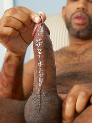Ebony man Ty Lattimore spreads his legs wide as he starts to jerk off