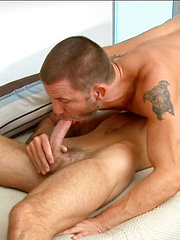 Sean swallows that cock all the way to the hilt as Brenn starts to fuck his pretty face