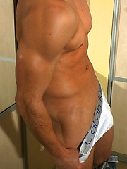 Young and sexy jock showing his hot beefy body