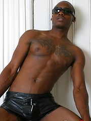 Black stud with tattoed chest