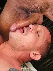 Sebastian slides his cock down Kyle's throat making him gag on uncut Latin cock