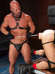 Dolan proves he's the biggest baddest Wolf in town when he opens his hole to muscular fisting top Mitch Vaughn