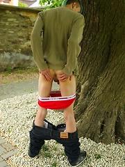 Pierced boy Jiminy masturbating outdoors.